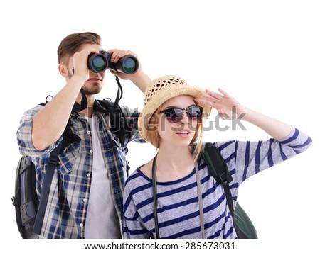 Pair of travelers with binoculars isolated on white - stock photo