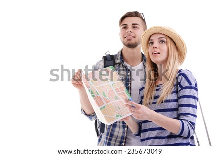 Pair of travelers with map isolated on white - stock photo