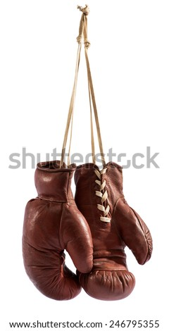 Pair of vintage brown leather boxing gloves hanging from a hook by their laces, isolated on white - stock photo