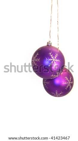 pair of violet balls hanging on a silver ribbon