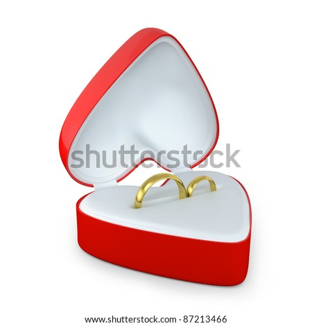 Pair of wedding rings in a heart shaped box isolated on white background