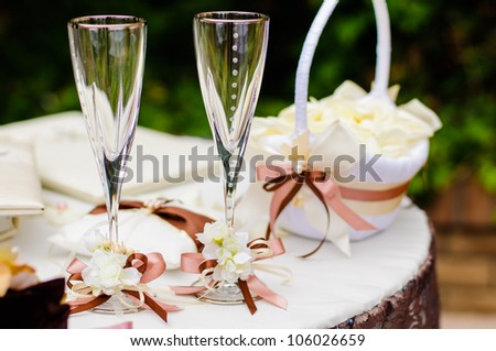 Pair of wedding wineglasses on the table - stock photo