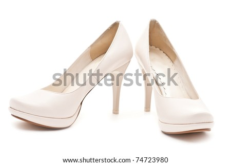 Pair of white female shoes isolated on white - stock photo