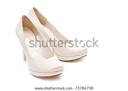 Pair of white female shoes isolated on white background
