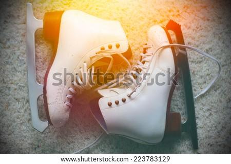 Pair of white ice skates - stock photo