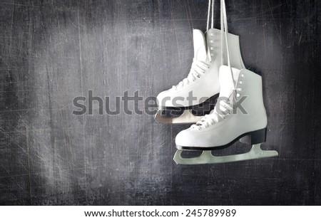 Pair of White Ice Skates. - stock photo