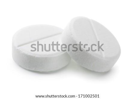 Pair of white pills isolated on white - stock photo