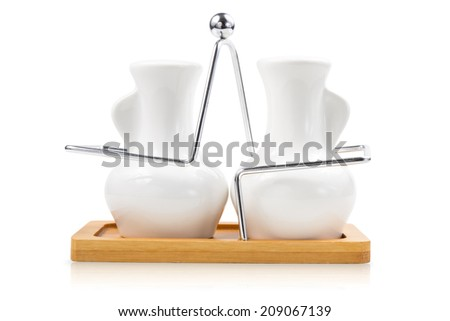 Pair of white seasoning bottles with handle tray isolated on white background.