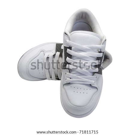 Pair of white sneakers isolated on white background - stock photo