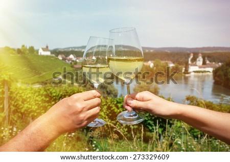 Pair of wineglasses against vineyards in Rheinau, Switzerland - stock photo