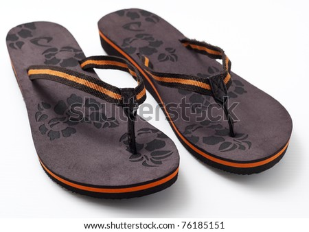 Pair of woman's sandal in brown color in white background. - stock photo