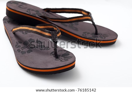 Pair of woman's sandal in white background. - stock photo