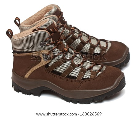 Pair of woman's trekking shoes isolated on the white background - stock photo