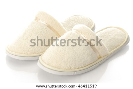 pair of women's fuzzy slippers with reflection on white background - stock photo