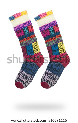 pair of woolen socks with a pattern isolated on white