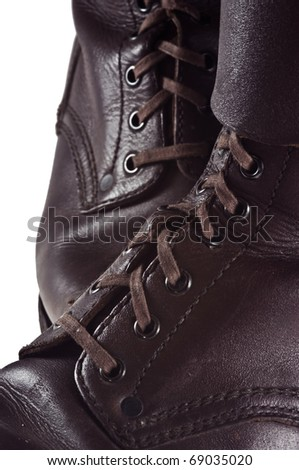 Pair of worn Polish army boots used in seventies of the twentieth century - isolated - stock photo