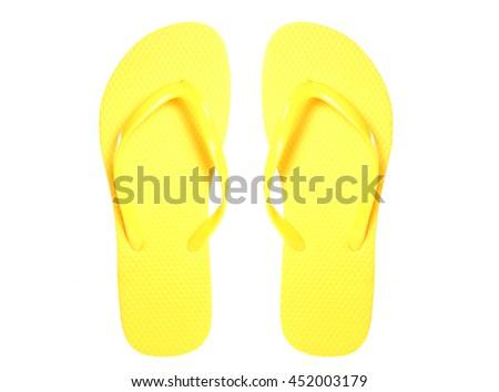 Pair of yellow flip flops cutout - stock photo