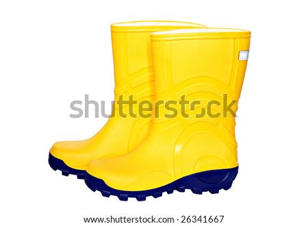 Pair of yellow rubber boots isolated on white - stock photo