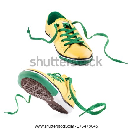 Pair of Yellow sneakers isolated on white - stock photo