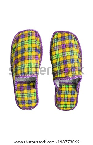 Pair of yellow squared slippers isolated over white