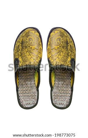 Pair of yellow textile slippers on white background - stock photo