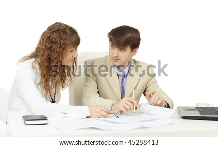 Pair of young businessmen on a workplace