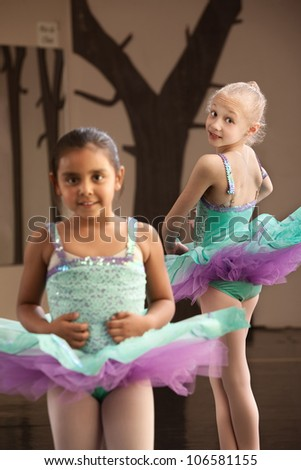 Pair of young female ballet students looking cute - stock photo