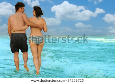 Pair on seacoast - stock photo