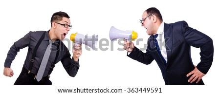 Pair shouting at each other via loudspeaker - stock photo