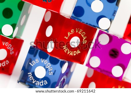 Pairs of colorful casino gaming dice from Las Vegas, Nevada on a white background. - stock photo