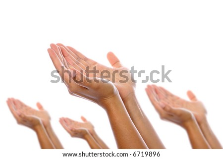 Pairs of hands placed together in gesture of seeking or request, isolated on white.