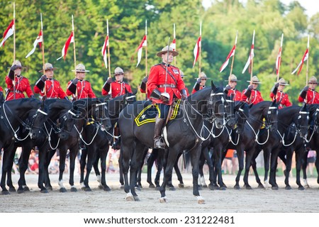 PAISLEY, ONTARIO - JUNE 6, 2012: The Musical Ride of the Royal Canadian Mounted Police is an event showcasing the equestrian skills of the thirty-two cavalry who are regular members of the force - stock photo