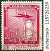 PAKISTAN - CIRCA 1951: A stamp printed in Pakistan issued for the 4th anniversary of Independence shows airplane and hourglass, circa 1951. - stock photo