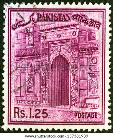 PAKISTAN - CIRCA 1961: A stamp printed in Pakistan shows the gateway of Chota Sona Masjid, Bangladesh, circa 1961. - stock photo