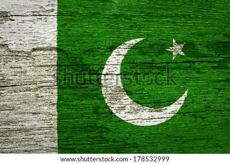 Pakistan Flag on old wood background  - stock photo
