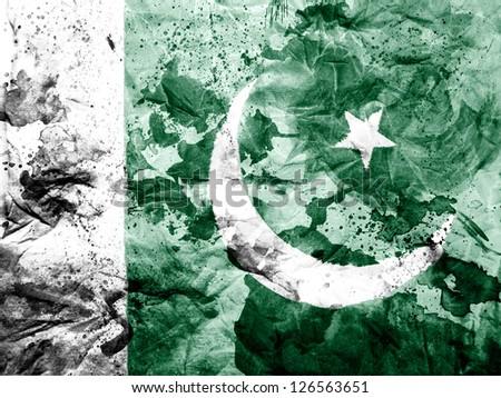 Pakistan. Pakistani flag painted dirty and grungy paper - stock photo