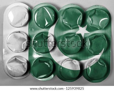Pakistan. Pakistani flag painted on tablets or pills - stock photo