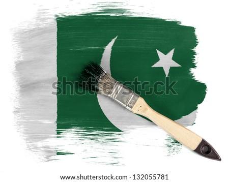 Pakistan. Pakistani flag painted with brush over it - stock photo
