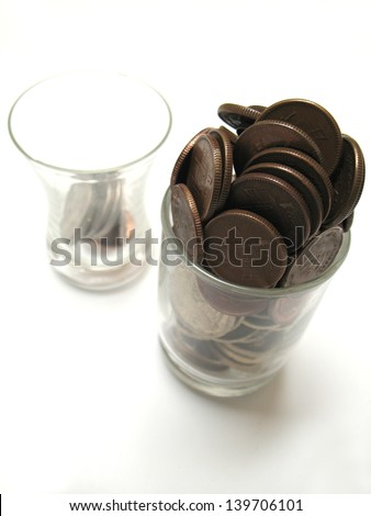 Pakistani coins in jar showing profit and lose - stock photo