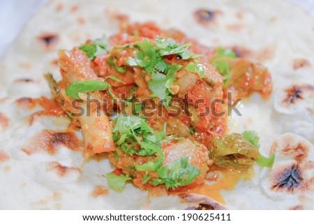 pakistani peshawari mutton karahi on naan - stock photo