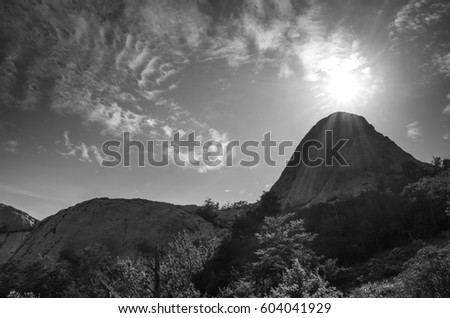Paklenica Velebit Croatia Europe. Black and white photo of beautiful nature and landscape in Dalmatia. Lovely sunny summer day with small clouds in sky. Nice mountain top and sun. Calm and peaceful