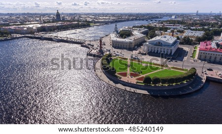 Palace bridge, buildings of Kunstkamera and old Saint Petersburg Stock Exchange is on the spit of Vasilyevsky island. Aerial view. The Neva river, St. Petersburg, Russia
