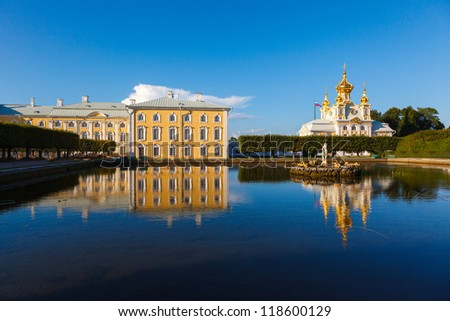 Palace church of Saints Peter and Paul in Peterhof in St. Petersburg in the summer sunshine - stock photo