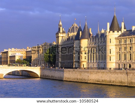 Palace Conciergerie riverside at overcast  sunset