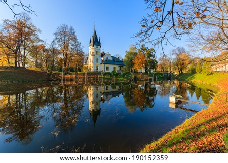 Palace in a park full of autumn colours, Olszanica, Poland - stock photo
