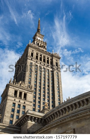 Palace of Culture and Science in Warsaw, Poland. The symbol of communism. Blue clear sky in the background - stock photo