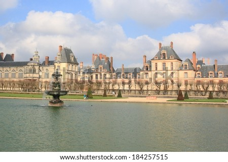 Palace of Fontainebleau and  lake, a unesco world heritage in France  - stock photo