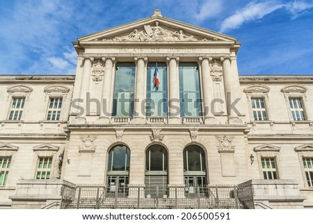 Palace of Justice (1885) - imposing law courts built in neoclassical style at Place du Palais in Nice, French Riviera, France. - stock photo