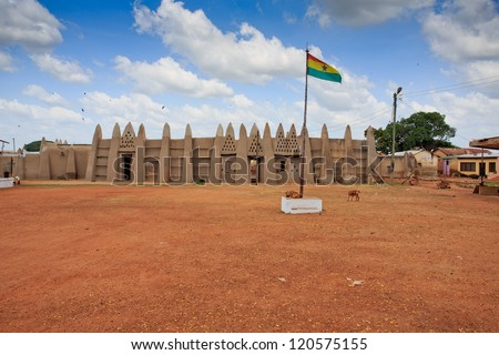 Palace of the Wa Na with Ghana flag, in Wa, Ghana - stock photo