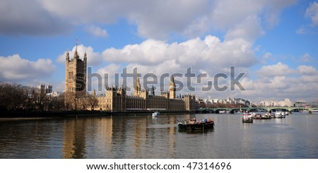 Palace of Westminster landscape looking across the Thames river - stock photo